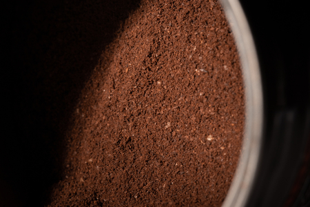 The texture of the ground coffee. Selected focus Фото со стока