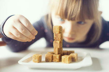 Child, sugar cubes. Problem of excessive consumption of sugar by children under the age of 10 years.