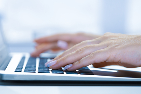 woman using laptop, searching web, browsing information, having workplace at home soft focus picture Vintage concept