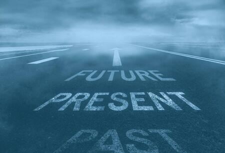 The concept of the past, present, future. Desert road in the mist. Archivio Fotografico