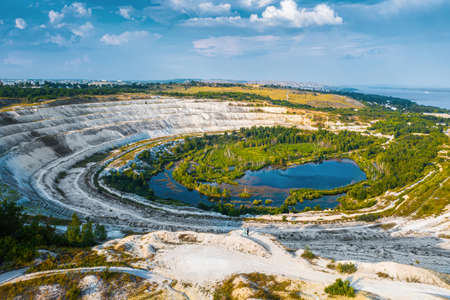 Old open-cast mine. Industrial extraction of chalk and by mining. Lake in quarry. Aerial. High quality photo