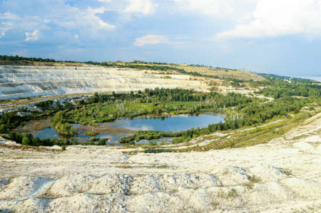Old open-cast mine. Industrial extraction of chalk and by mining. Lake in quarry