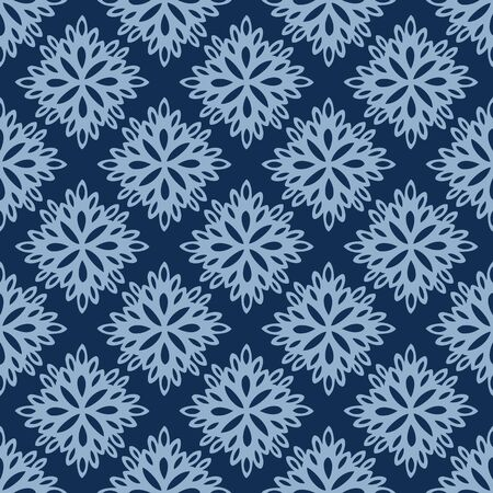Seamless vector pattern of lacy paper flowers on classic blue background. Pretty hand drawn elements resembling paper cut outs can used as a backdrop, background, textile, paper and more.