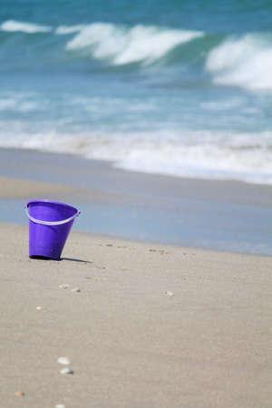 Purple Pail on Beach 写真素材