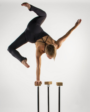 handed: Girl doing a one handed handstand