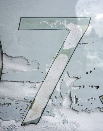 Written Wording in Distressed State Typography Found Number Seven 7