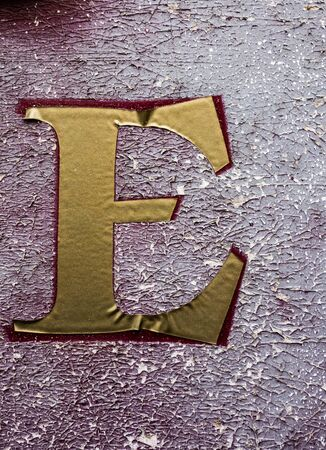 Written Wording in Distressed State Typography Found Letter E