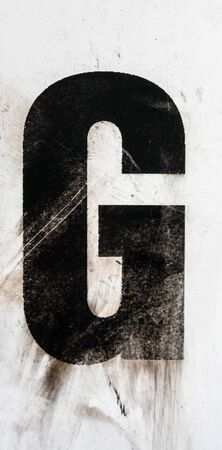 Written Wording in Distressed State Typography Found Letter g