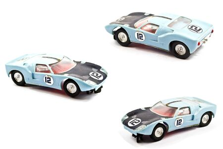 Vintage Children's Toy Racing Car Played With on White Background