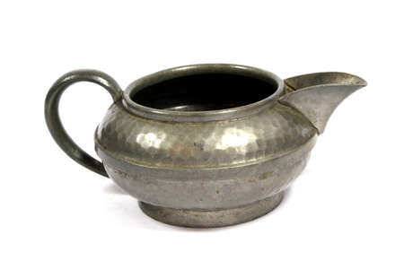 A Vintage Antique Kettle or Tea Pot In Metal on White Background