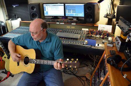 Man Working In Music Recording Studio photo