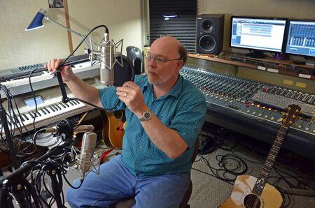 recording studio: Audio Engineer Setting Up Recording Studio For Session