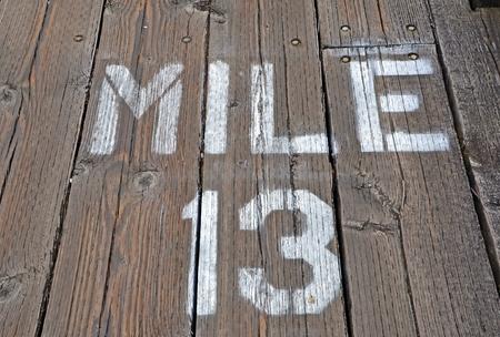 mile: Mile 13 Painted On Boardwalk
