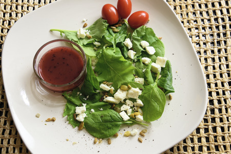 sunflower seeds: Healthy greens with feta. tomato and seeds Stock Photo