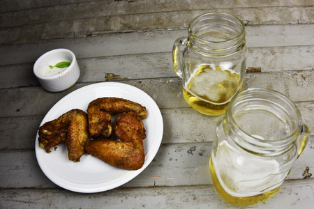ale: Microbrewed Craft Ale Beer  with Chicken Wings Stock Photo
