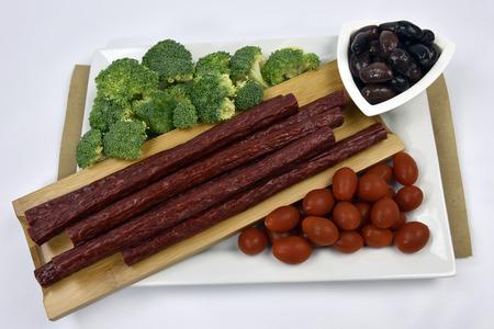 Fresh smoked beef sausage sticks, kalamata olives and organic vegetables
