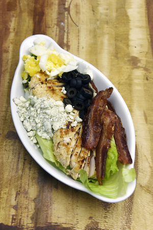 Bacon with chicken, blue cheese, egg and olives Stockfoto