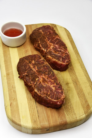 Raw grass fed beef steaks ready to cook