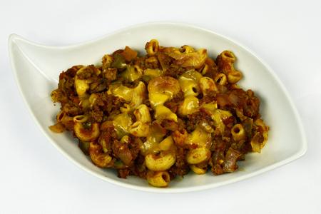 pasta: Cheeseburger macaroni casserole with mushrooms onion and tomato Foto de archivo