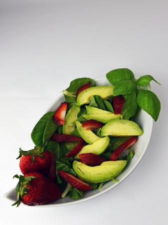 bok choy: Fresh Avocado strawberry spinach kale bok choy basil salad isolated on white background