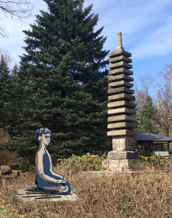 yoga. man meditating next to the pagoda