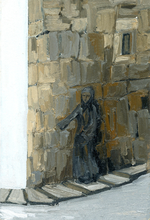 the woman stands at the brick wall