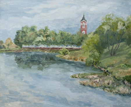 village on the river bank, rural landscape with a church Standard-Bild - 125431877