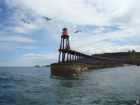 The east pier of whitby harbour seen from out to sea Stock Photo - 5112509