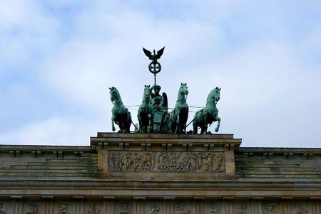 quadriga: The statue of Quadriga on top of the Brandenburg Gate in Berlin