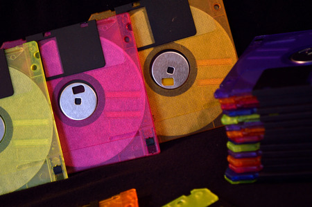 Colorful, but outdated, floppy disks. 版權商用圖片 - 54739040
