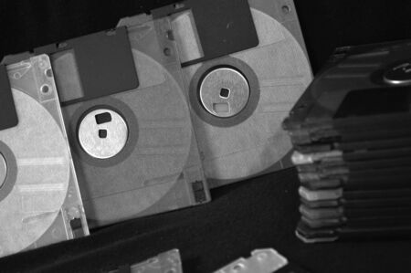 Black and white photo of floppy disks in old fashioned photo style