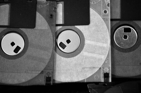 disks: Black and white photo of floppy disks in old fashioned photo style