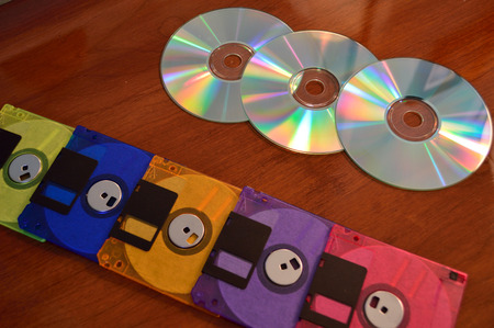 Floppy disks, and cd roms, showing progression of technology. 版權商用圖片