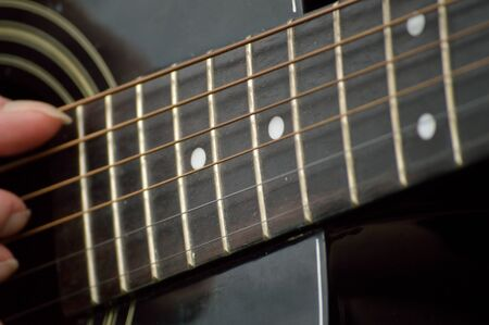 fret: Black guitar closeup of the neck or fretboard.