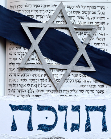 hebrew script: Hebrew word hanukkah or chanukah. Jewish holiday, festival of lights. With star of david, against hebrew tanakh text of the book of Isaiah