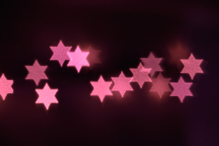 Beautiful bokeh lights in shape of the Star of David for Hanukkah celebration. Jewish Holiday background.