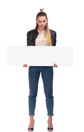 blond girl with nameplate on white background Stock Photo