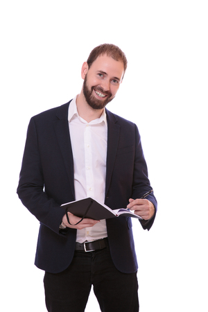 man standing with notebook and making remarks