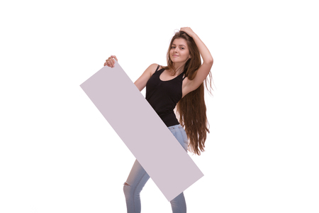 young woman posing with big nameplate or empty blank isolated on white background