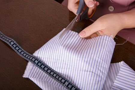 sewing machines: Process of sewing. Fabric cutting Centimeter Hands