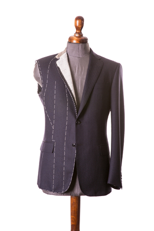 Work in Progress Suit without sleeve on Mannequin with Exposed Stitching isolayed on white background