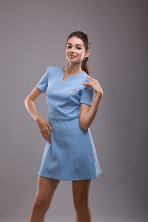 Beautiful sexy young business woman brunette hair evening makeup wearing blue dress business clothes for meetings walks summer fall collection perfect body shape