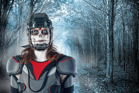 Happy halloween. hockey player in a hockey helmet and mask against the backdrop or background of scary forest. holiday halloween. All Saints Day