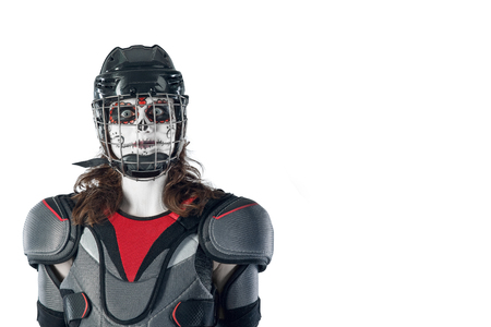 Happy halloween. hockey player in a hockey helmet and mask against the isolated backdrop or background. holiday halloween. All Saints Day