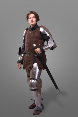 portrait of a medieval female knight in armour with sword isolated over grey background Stock Photo - 88901337