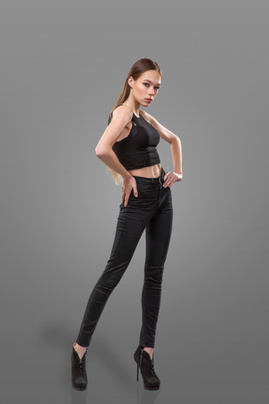 Very thin Young woman staying isolated on grey background. Isolate. Anorexia Stock Photo