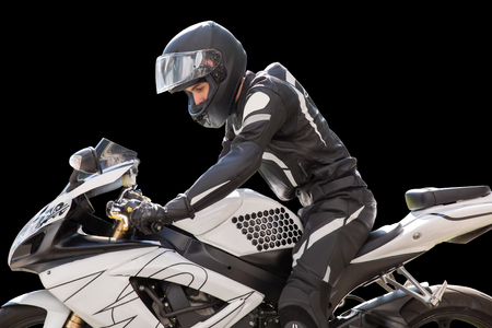 Portrait of motorcyclist with helmet on black background. motorcycle rider