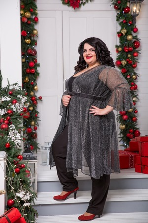 portrait of beautiful plus size young woman. New year or Christmas background 스톡 콘텐츠