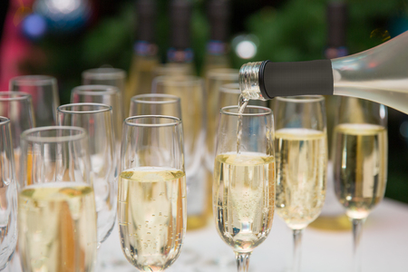 glasses of champagne. the waiter pours wine into glasses on a buffet table. reception Stock Photo