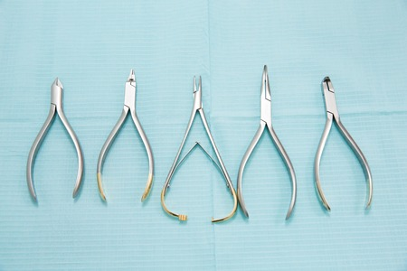 many dental pincers. dental clamps set. Dental concept Stock Photo